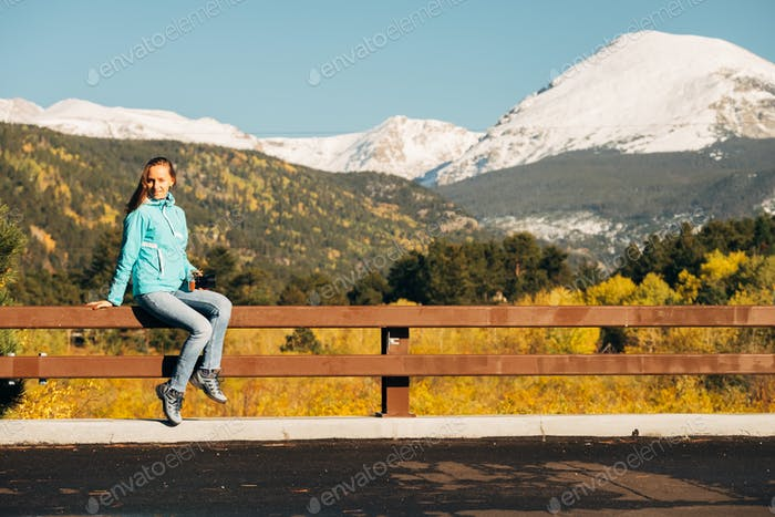Tourist in Rocky Mountains at autumn, Colorado, USA.