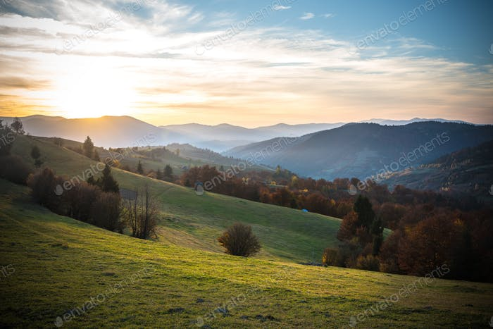 Fantastic magnificent sunrise in morning mountain village