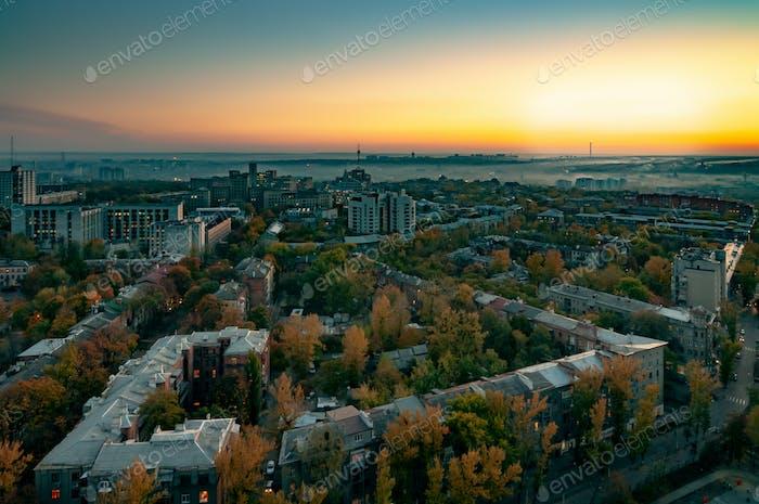 Aerial view of sun rises over summer European city
