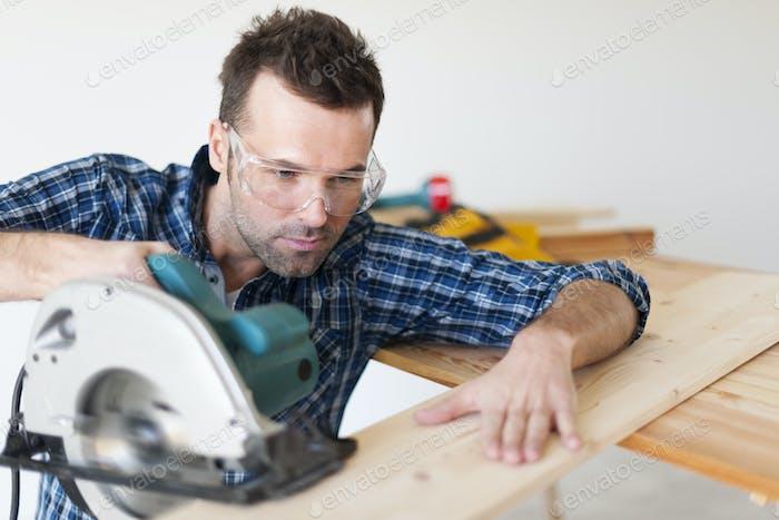 Portrait of focus carpenter at work