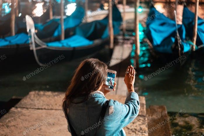 Beautiful Young Traveler Woman Taking Photos in Venice