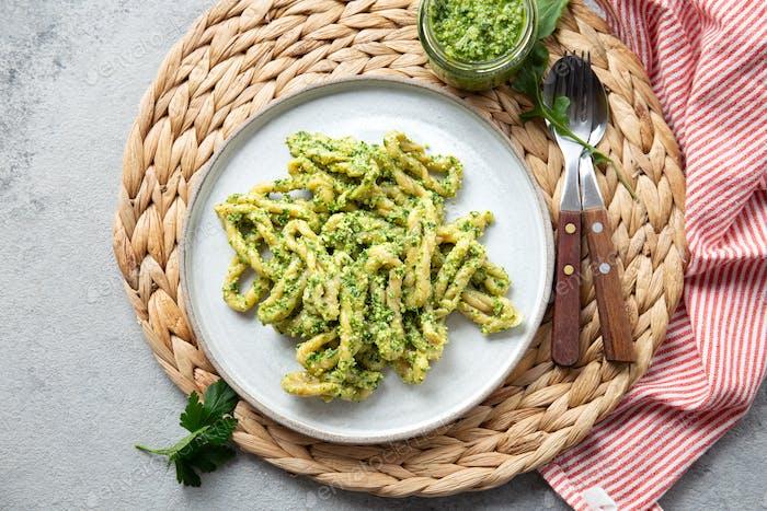 Pasta Lorighittas of Sardinia. Loriguittas with herb sauce pesto. in White plate.