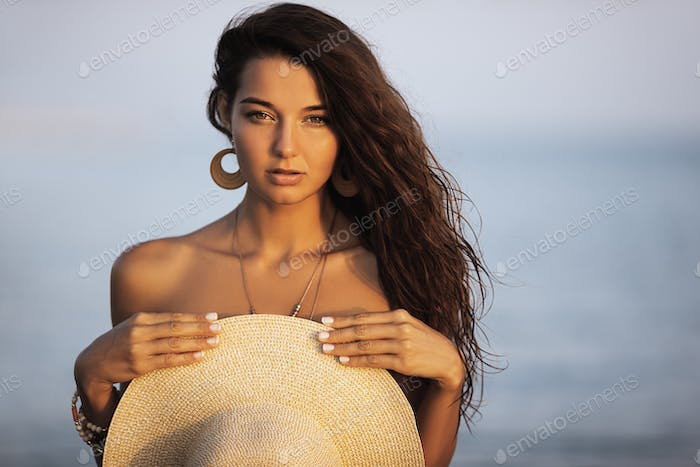 Tanned Woman Resting in Water During Summer Vacations