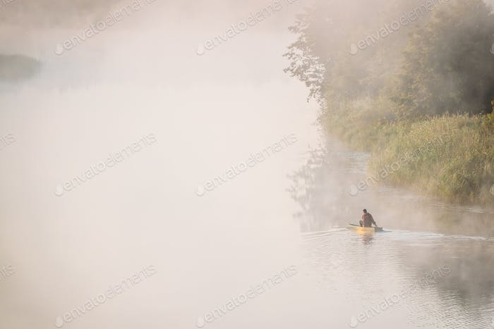 Calm Lake, River And Man Fishing From Old Wooden Rowing Fishing
