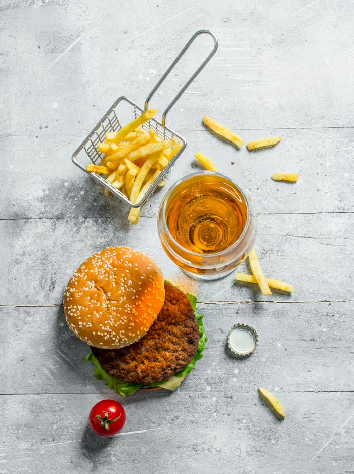 Burger with beer and fries.