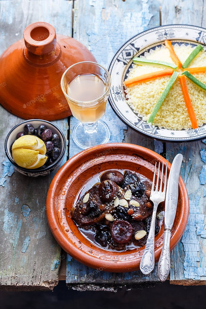 Traditional moroccan dishes: beef tajine, couscous, olives and salted lemons. Rustic style
