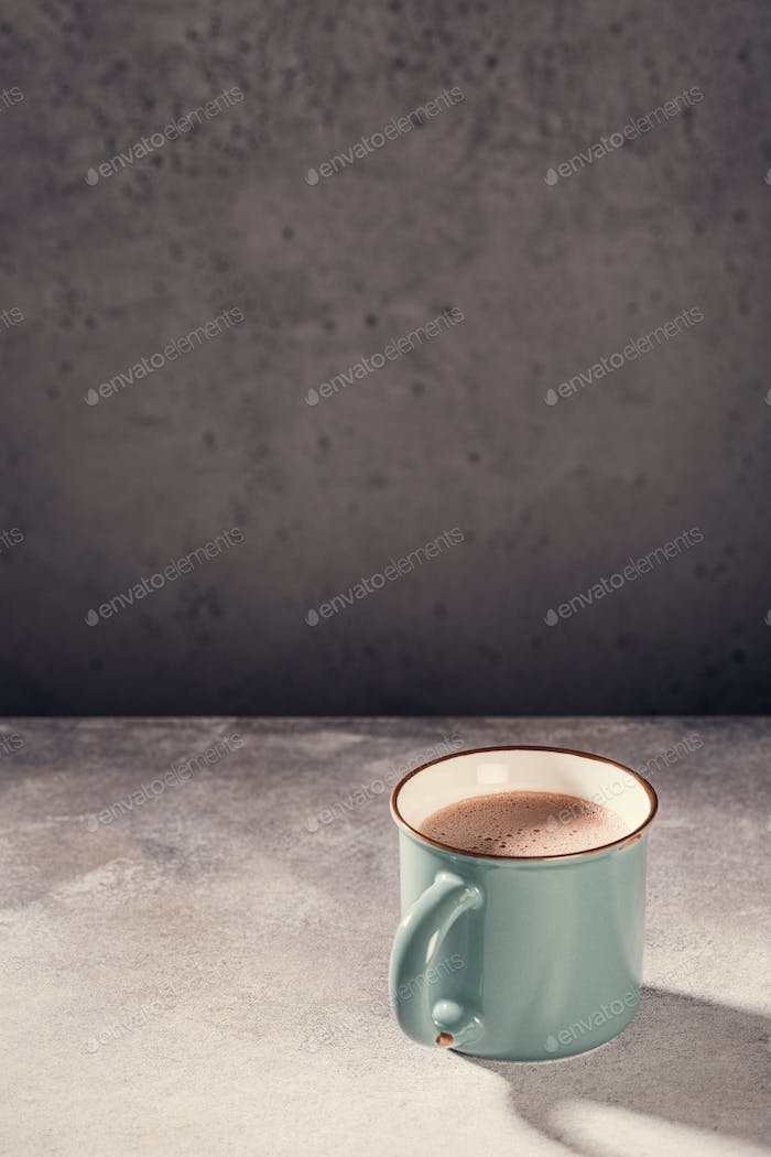 Old mug with hot chocolate milk
