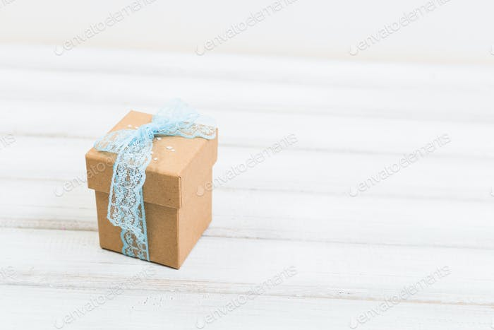 Gift box on old wooden background.