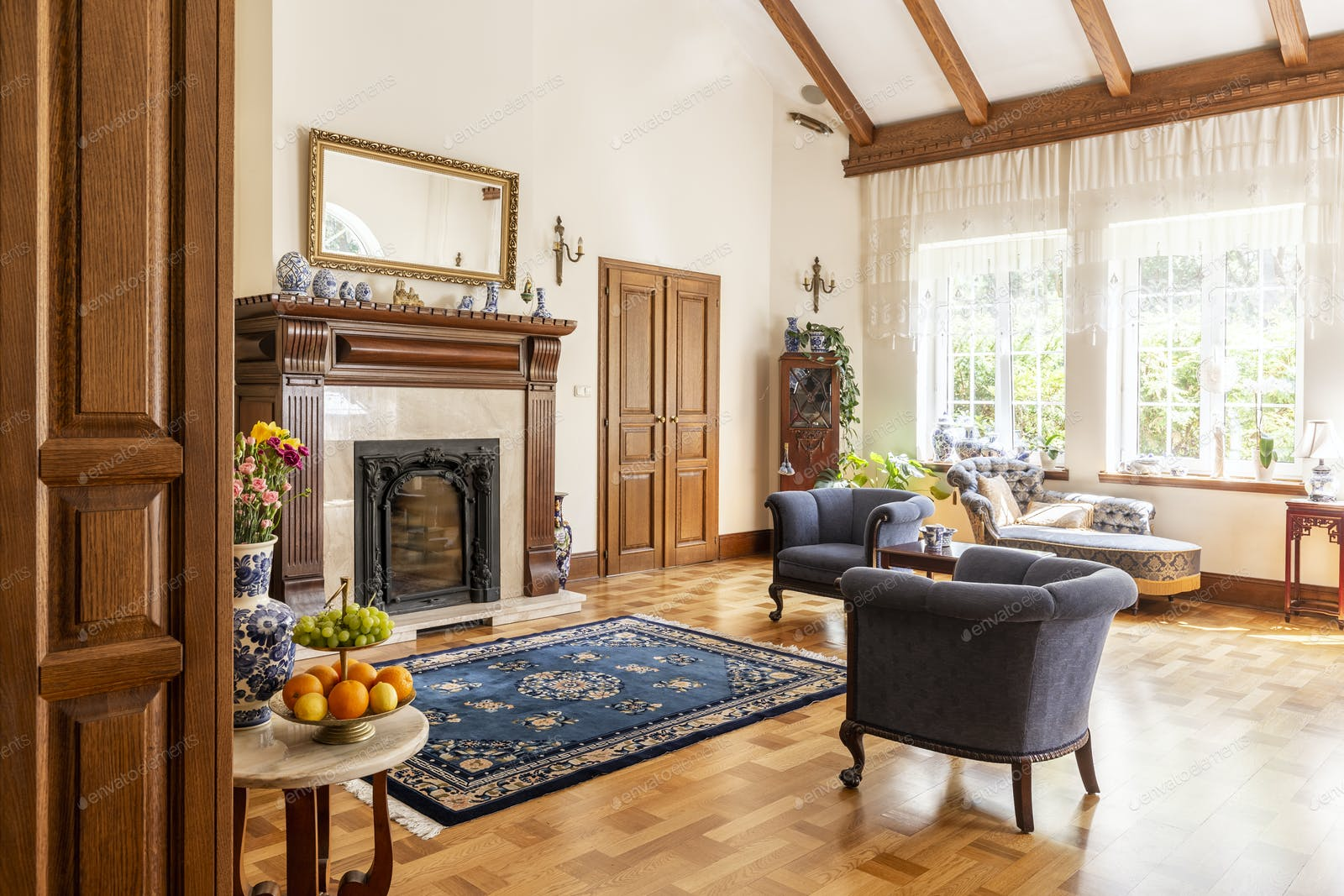 Blue Armchairs And Patterned Carpet In