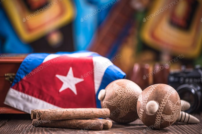 Items related to Cuba on wooden table