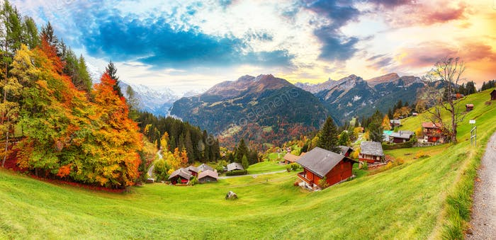 Gorgeous panorama over picturesque alpine village Wengen at autumn.