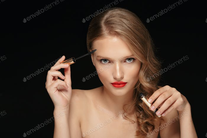 Portrait of young attractive lady with wavy hair and red lips ho
