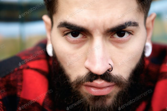 Male fashion model with piercings