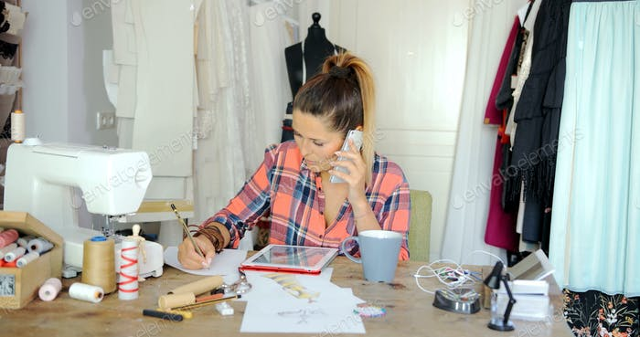 Female tailor in process of working