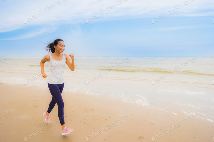 Portrait beautiful young sport asian woman exercise by run and j