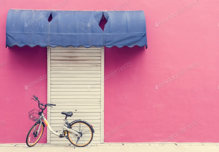 Pink wall with a bicycle