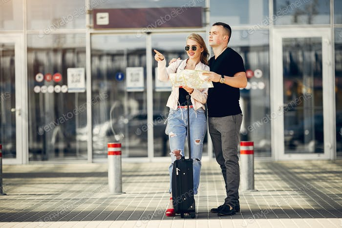 Beautiful couple standing in a airport