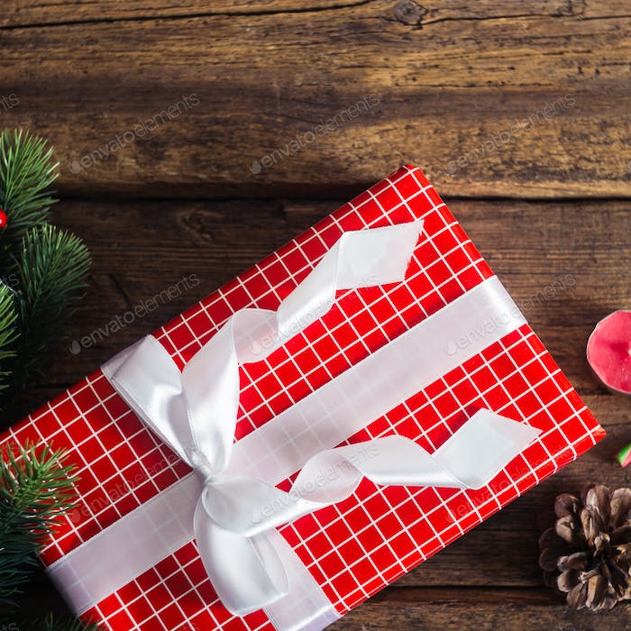 Christmas presents on a wooden background with candy cane