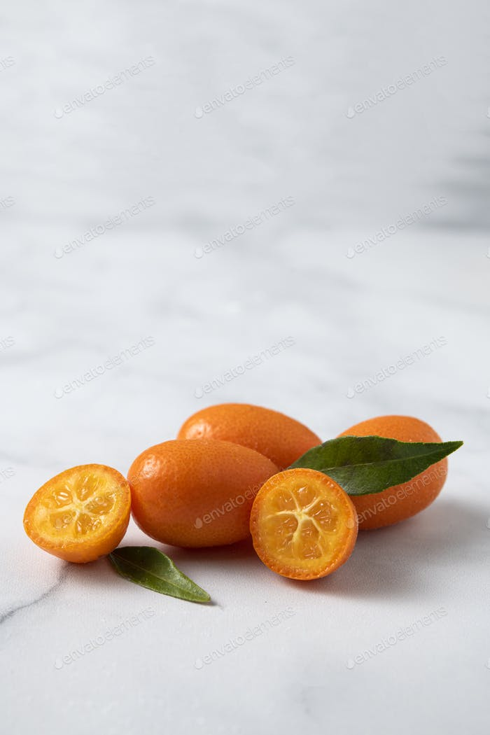 Kumquat fresh fruits on white marble