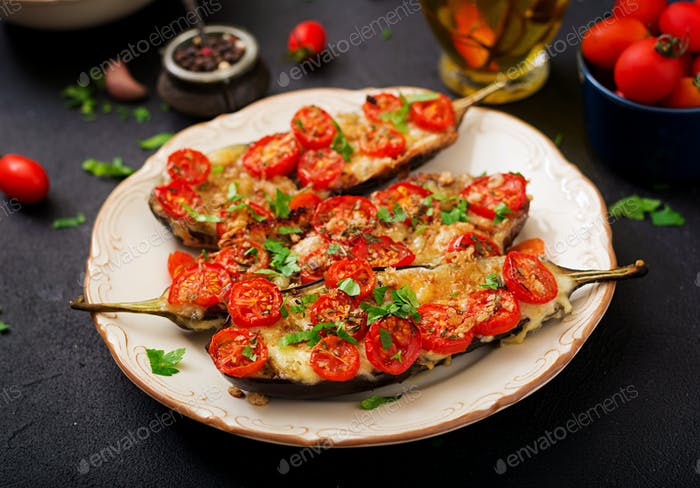Baked eggplants with mozzarella and tomatoes with Italian herbs