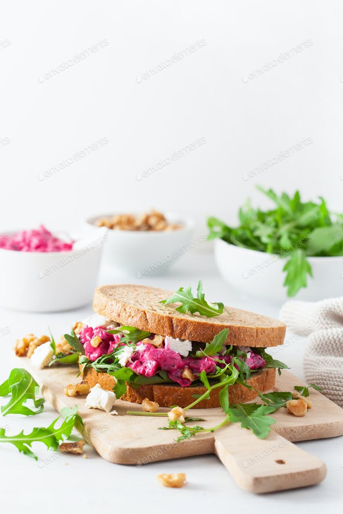 beetroot and feta cheese sandwich with walnuts and rocket