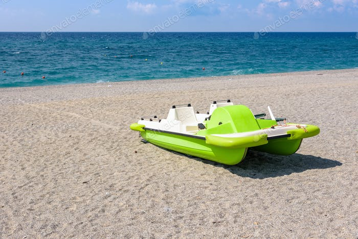 Pedalo on a gravel beach