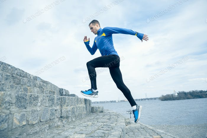 Man running on city background at morning.