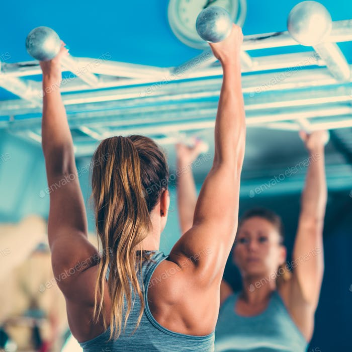 Thumbnail for Female athlete doing pull-ups in the gym