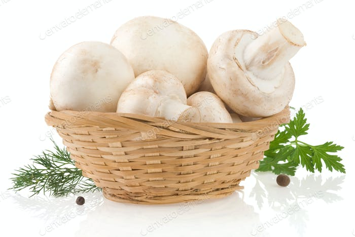 mushrooms and basket with spices isolated on white