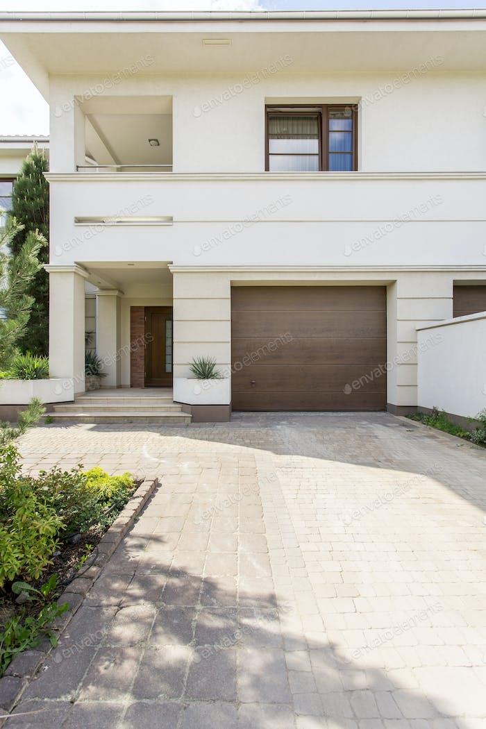White modern house with garage