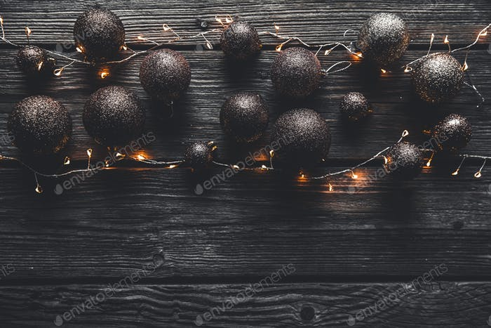 Christmas or New Year background. Vintage Christmas tree toy decoration balls and light garland