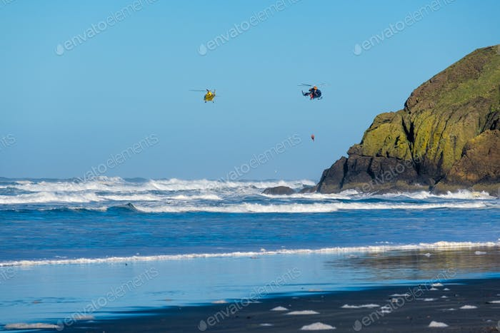 Pacific coast, USA. Coast guard helicopters in the sky.