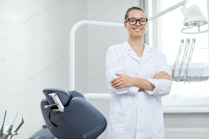 Professional Female Dentist Posing in Office