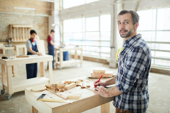 Mature Carpenter Looking at Camera