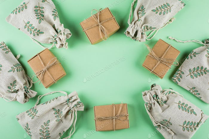 Zero Waste Gift Wrapping Eco-friendly Lifestyle. Craft Boxes and Pouches on green background