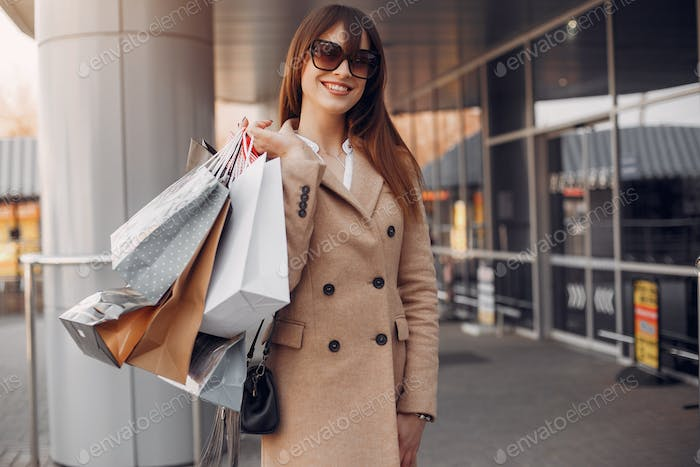 Woman with shopping bag in a city