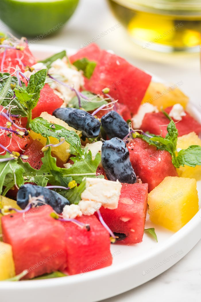 Serving Summer Fresh Watermelon Salad with Fresh Mint and Lime J