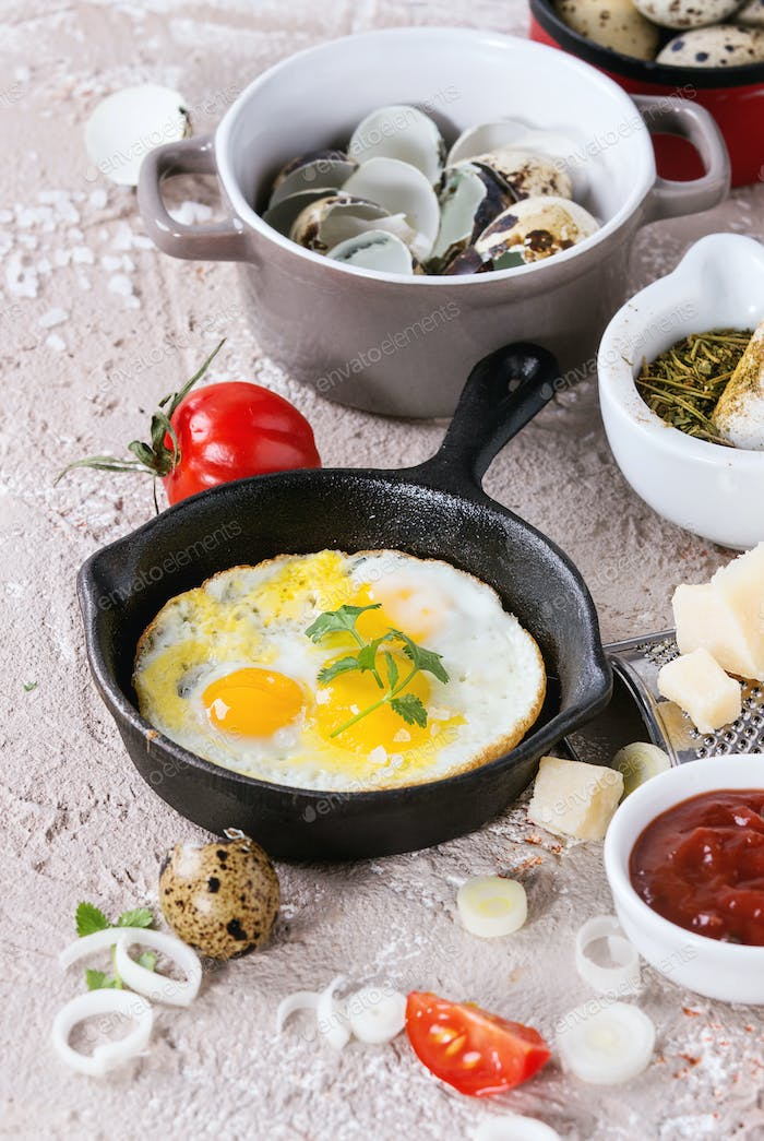 Breakfast with fried quail eggs