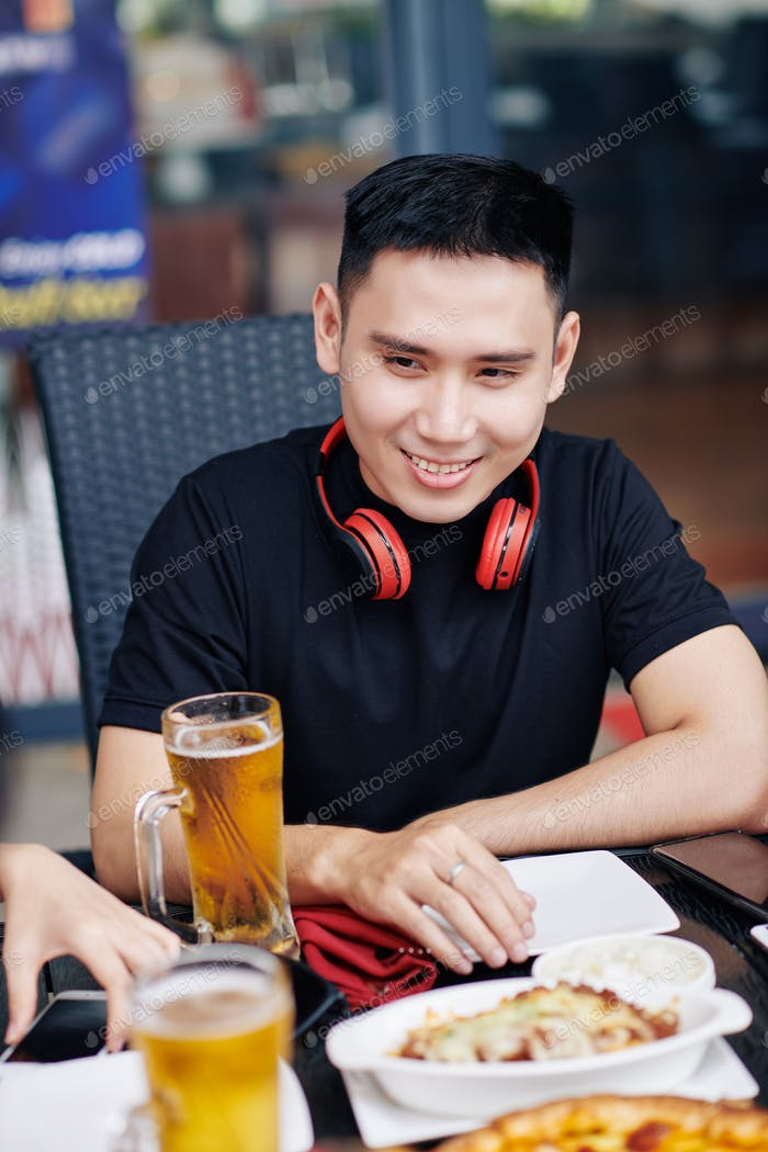 Asian man sitting in cafe