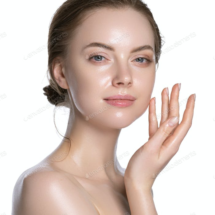 Young girl healthy hydration clean skin face beautiful model neck shoulders. Isolated white.