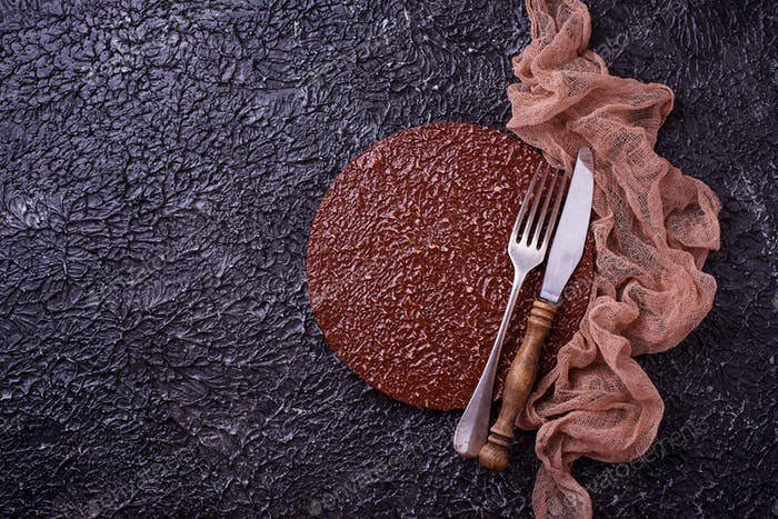 Empty cutting board or plate with cutlery on concrete background
