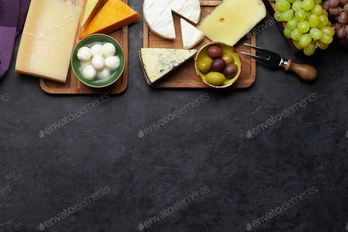 Various cheese, grapes and olives