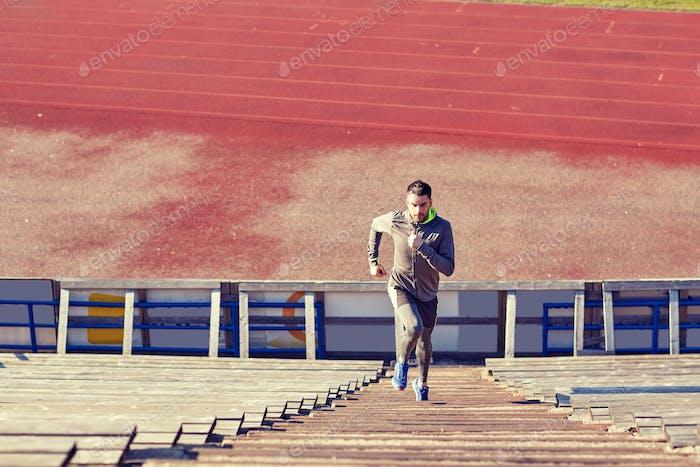 man running upstairs on stadium
