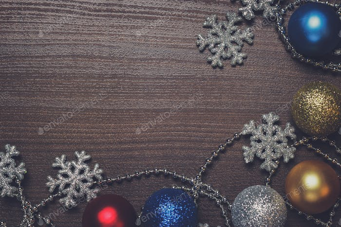 shiny christmas decoration on brown wooden background