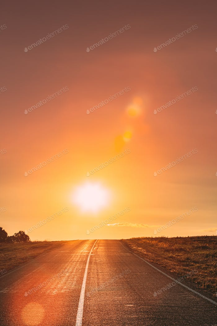 Sun Shine Above Asphalt Country Open Road In Sunny Sunrise Morning. Open Road In Summer Or Autumn