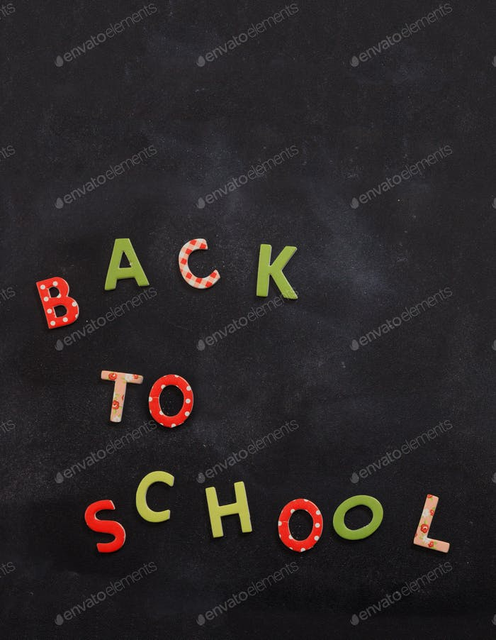 Back to school text colorful letters on black board