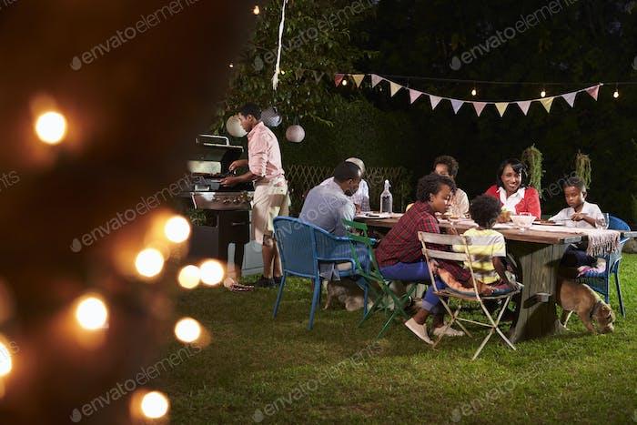 Multi generation black family enjoying a barbecue dinner