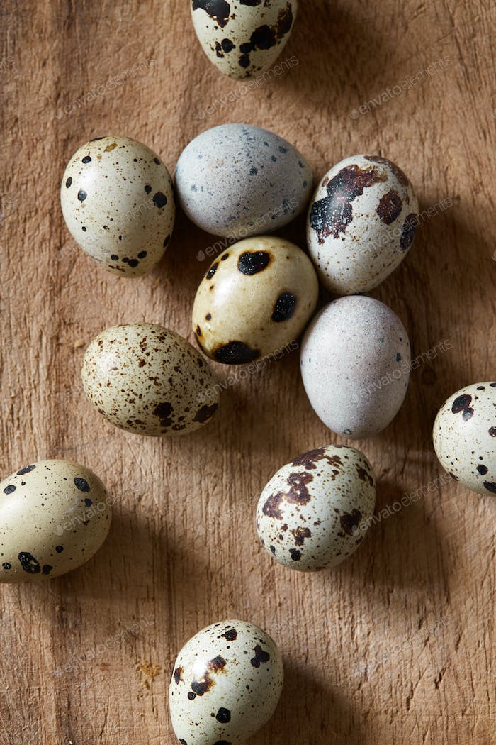 Quail eggs on old wooden cutboard