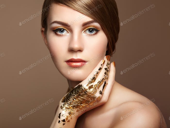 Magic woman portrait in gold
