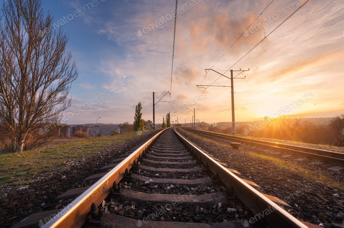 Railroad against beautiful sky at sunset. Industrial landscape
